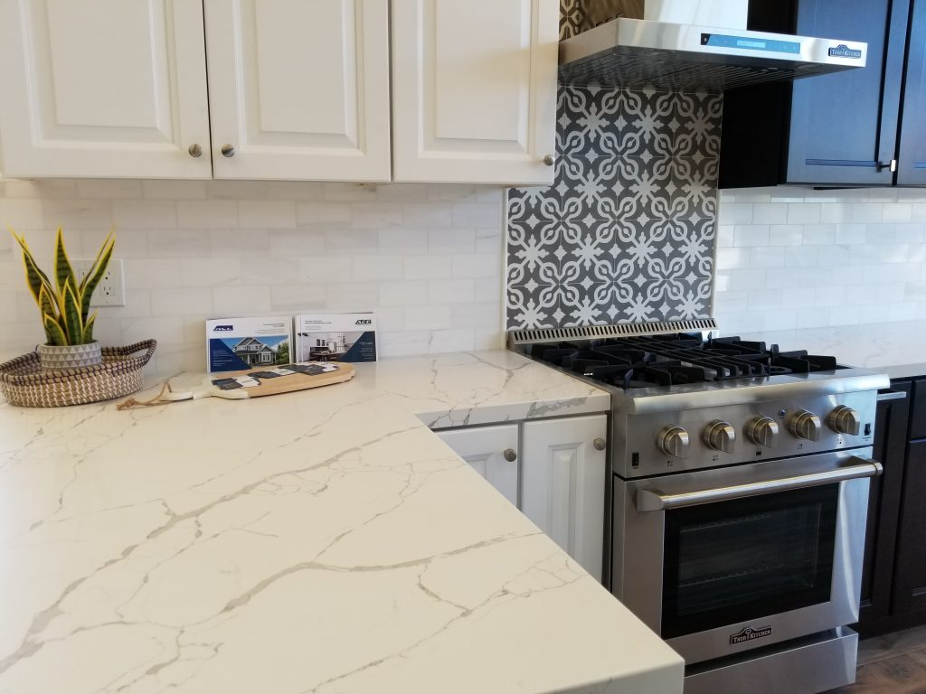 White and Espresso Cabinets, Quartz Carrara  Countertop, Cement and Marble Backsplash, Thor Appliances